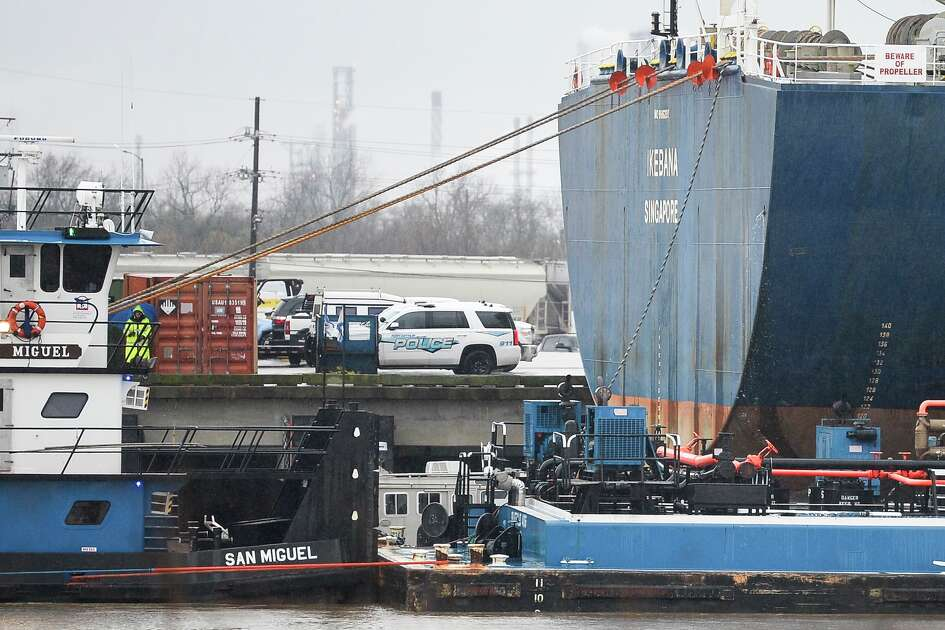 Emergency personnel are working on removing a body from the water in Port Arthur January 23, 2019. Photo: Ryan Welch/The Enterprise