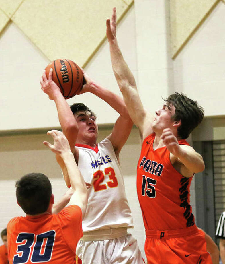 Roxana's Gavin Huffman (23) shoots over Pana's Jack Armstrong (right) last week at the Litchfield Tournament. On Tuesday night, Huffman scored a career-high 30 points in a victory over Metro-East Lutheran in Edwardsville. Photo: Greg Shashack / The Telegraph