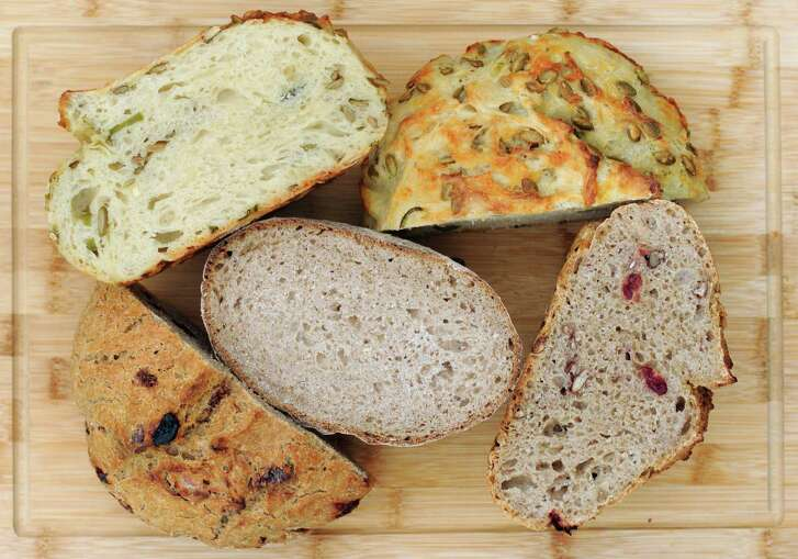 Sourdough can be simple, like our Basic Sourdough Loaf (center) or packed with flavors, as in the Jalapeño Cheddar Sourdough Loaf (top) or Pecan Cranberry Sourdough Loaf (bottom).
