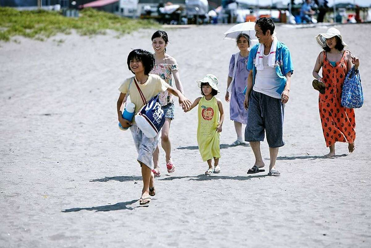 The family in 'Shoplifters' takes in a young girl even though they can't afford it.