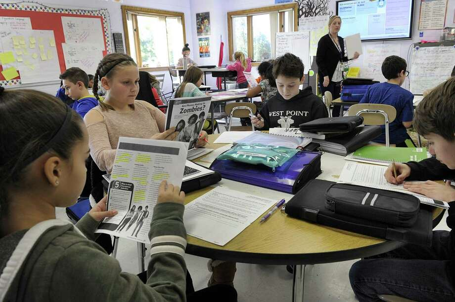 Teacher Cathy Emerick's sixth-grade language arts class at the Bethel Middle School Thursday, Oct. 25, 2018. The Bethel Middle School is particularly big this year and the sixth grade is the biggest grade in the district with 275 students. Photo: Carol Kaliff / Hearst Connecticut Media / The News-Times