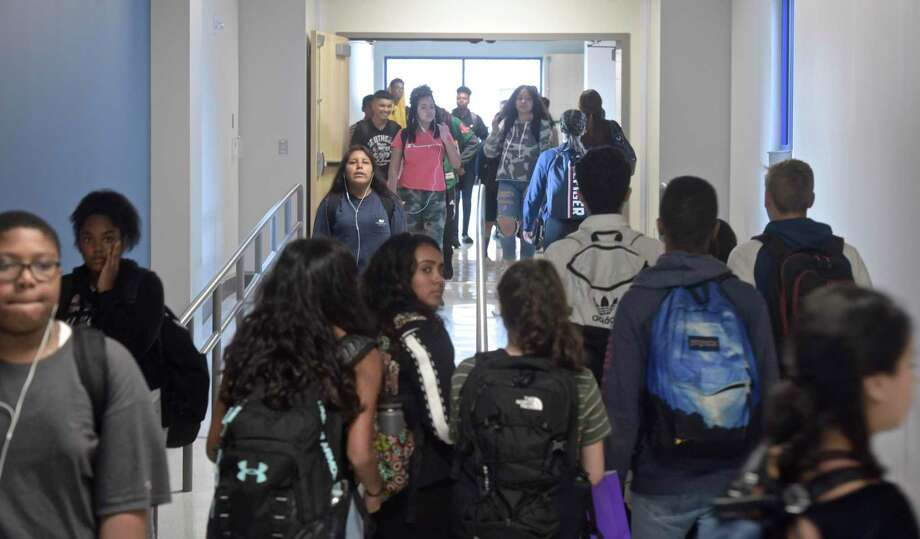 Students fill the hallway of the new addition at Danbury High School between classes in October. Photo: H John Voorhees III / Hearst Connecticut Media / The News-Times