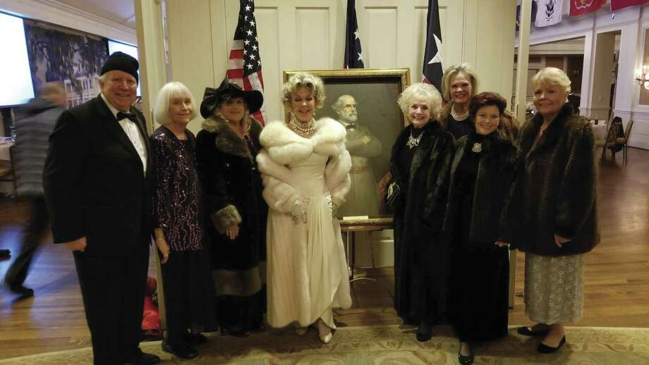 Douglas Collings, of the Sons of Confederate Veterans, escorted members of the Rebel Joan of Arc Chapter of United Daughters of the Confederacy to the Southern Heritage Ball Jan. 19 in Houston's River Oaks Country Club. The ball honored four Houston debutantes, and observed the 212th birthday of General Robert E. Lee. Attending from this area were left to right: Douglas Collings, Peggie Miller, Cindy Dittrich, Lyn Howard, Elaine Collings, Donna Summers, Anita Stevens, and potential member Sandy Flynn.
