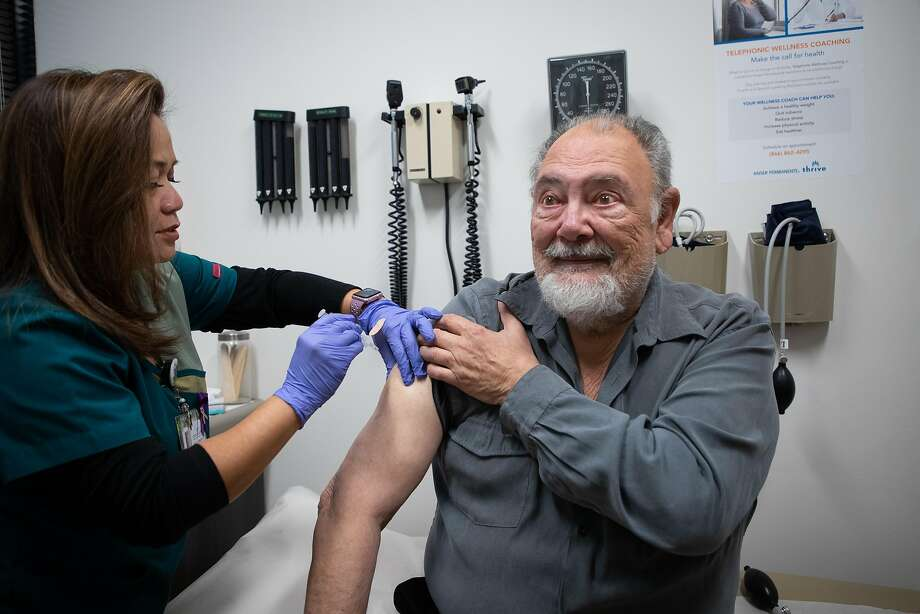 Ilda Villahermosa administers a flu shot to Eugene Thiers, 77, of San Mateo, at Kaiser Permanente Redwood City. Photo: Jim Gensheimer / Special To The Chronicle