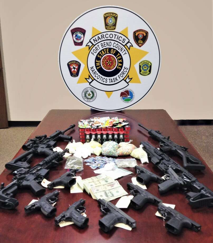 A cache of guns, drugs and money was found after surprise raid in southwest Houston. Photo: Fort Bend County Sheriff's Office