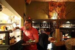 Jay Beaman serves dinner at Firefly in San Francisco, Calif. on Thursday, January 3, 2019.