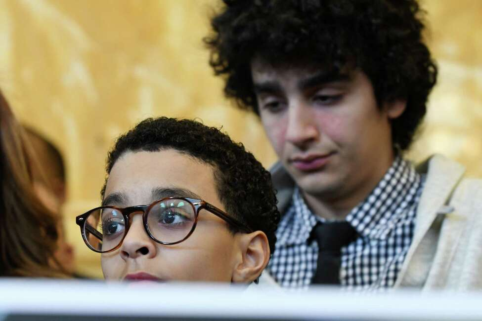 Myles ,left, and Matthew Peralta, right, sons of the late Sen. Jose Peralta, attend a press conference to announce the pending passage of the Jose Peralta New York State Dream Act, which is named after their father, on Wednesday Jan. 23, 2019, at the Capitol in Albany, N.Y. (Will Waldron/Times Union)
