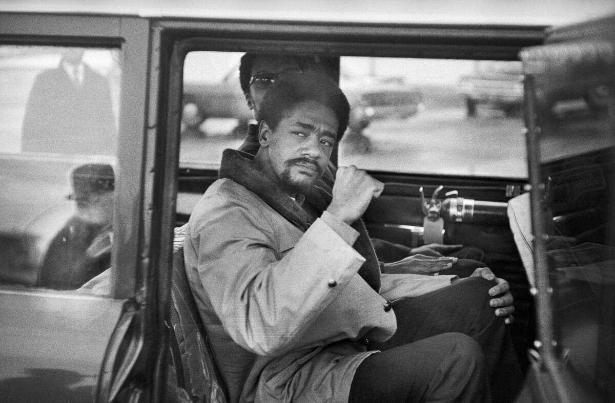 Black Panther leader Bobby Seale gives a black power salute as he leaves Hartford's Bradley Airport for the trip to New Haven. Seale faced trial in connection with the murder of Alex Rackley. Perhaps the strongest Connecticut tie in the movie isBobby Seale. As mentioned in the movie, the Black Panther Party leader was headed back to Connecticut for a murder trial after his court appearance in Chicago. However, the movie took some liberties with the details of his case. In real life, Seale was accused of conspiring to kidnap and murder a suspected FBI informant (Alex Rackley) - not a police officer, as the movie version would have you believe.