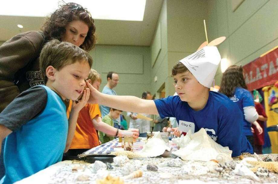 Students in both public and private schools are likely perfecting their poster boards and ensuring they have all necessary materials to demonstrate their projects at the upcoming SCI://TECH 2019 exposition, the 29th annual event hosted by Education for Tomorrow Alliance and Conroe ISD. Here, Galatas Elementary School student Clay Cassard shows a a boy a conch during the 2016 SCI://TECH Expo at the Lone Star Convention and Expo Center. Photo: Jason Fochtman / Staff Photographer