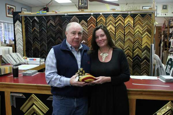 Tom Geary with his wife Anne Geary inside their business. Taken Jan. 22.