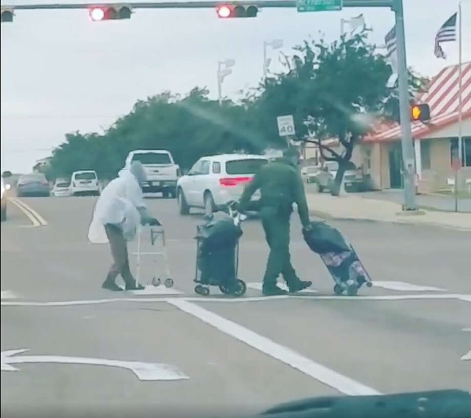 In a video posted on Facebook Wednesday, a Laredo Border Patrol agent is seen helping an elderly individual through a busy intersection. Photo: Courtesy Laredo Kickboxing Academy