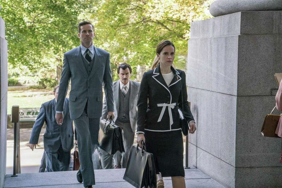 "In this image released by Focus Features, Armie Hammer portrays Marty Ginsburg, from left, Justin Theroux portrays Melvin Wulf and Felicity Jones portrays Ruth Bader Ginsburg in a scene from ""On the Basis of Sex."" (Jonathan Wenk/Focus Features via AP) Photo: Jonathan Wenk / Associated Press / © 2018 Storyteller Distribution Co., LLC. All Rights Reserved."