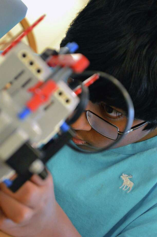 Akhil Polaki, 10, of Darien, focuses on his project at the 5th annual Hack-a-Thon at St. Luke's School, Saturday, Jan. 19, 2019, in New Canaan, Conn. Left, Claire Watson, 15, of New Canaan, works on her project at the 5th annual Hack-a-Thon at St. Luke's School, Photo: Jarret Liotta / For Hearst Connecticut Media / New Canaan News Freelance