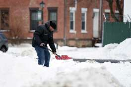 Krone Brown shovels snow in the parking lot of the T S Mini Mart on Wednesday, Jan. 23, 2019 on South Pearl Street in Albany, N.Y. (Phoebe Sheehan/Times Union)