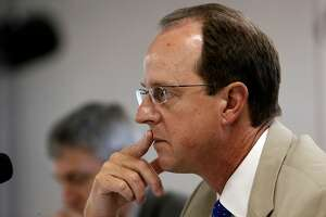 Steve Heminger, executive director of the Bay Area Toll Authority listens to comments during a public meeting of the Toll Bridge Program Oversight Committee in Oakland, Calif., on Tues. October 13, 2015, to discuss repair options on the flooded rods on the new Bay Bridge.