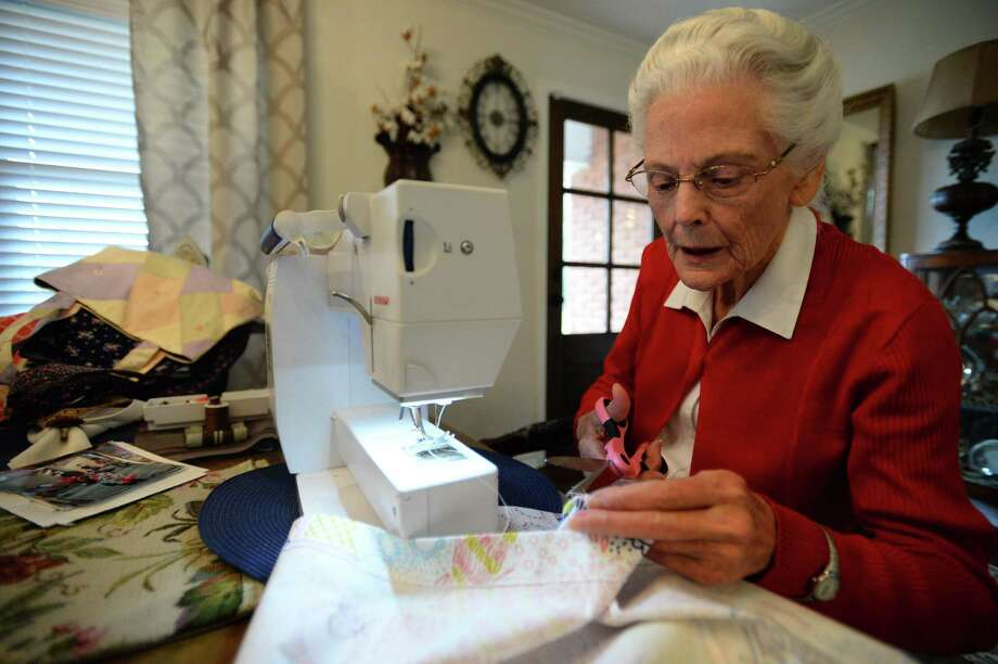 Mavis Pippin works on a dress in her grandson's house on Tuesday. Pippin has made over 1,000 dresses over the last two years for underprivileged girls in Haiti.  Photo taken Tuesday 01/15/19 Photo: Ryan Welch/The Enterprise / The Enterprise / ©2019 The Beaumont Enterprise