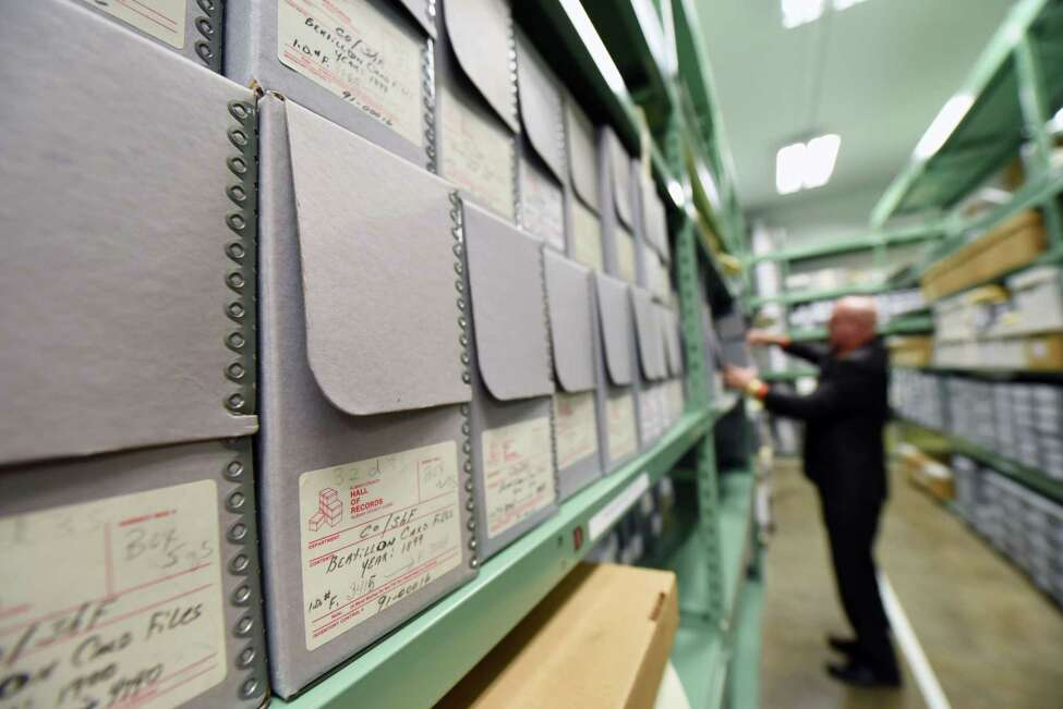 Albany County Clerk Bruce Hidley goes through boxes of old mugshots on Wednesday, Jan. 16, 2019 at the Albany County Hall of Records in Albany, N.Y. (Phoebe Sheehan/Times Union)