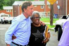 Ned Lamont and State Senator Marilyn Moore walk together through the Second Stoneridge co-op, during a campaign stop to visit with residents at the co-op on Yaremich Drive in Bridgeport, Conn., on Tuesday, June 5, 2018.