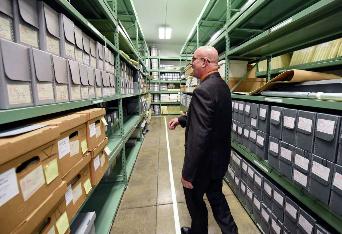 Albany County Clerk Bruce Hidley walks through aisles of preserved old boxes of mugshots on Wednesday, Jan. 16, 2019 at the Albany County Hall of Records in Albany, N.Y. (Phoebe Sheehan/Times Union)