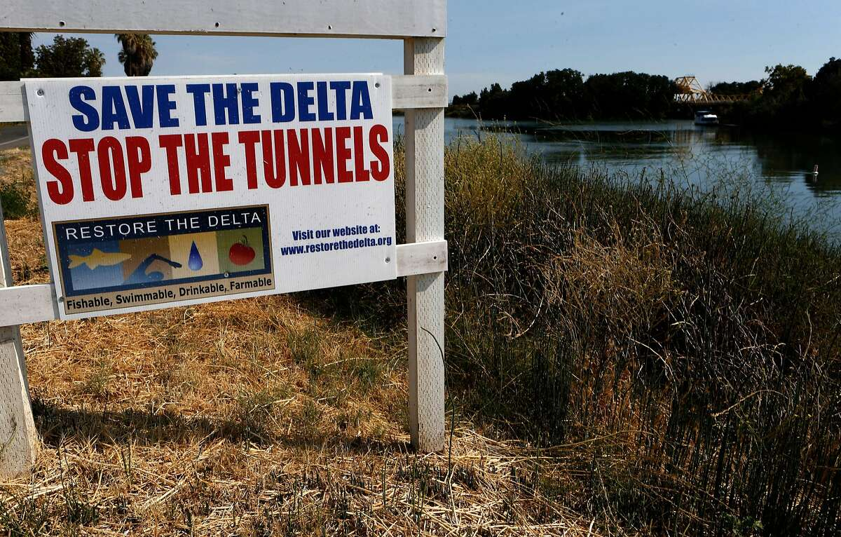 Signs along River road on the Delta waters of the Sacramento River, Calif., as seen on Wednesday July 30, 2014., near Rio Vista, Calif. The Bay Institute, a well-regarded environmental group, has determined the the Bay Delta Conservation Plan to construct tunnels to send water south would cause two salmon species to die out and would