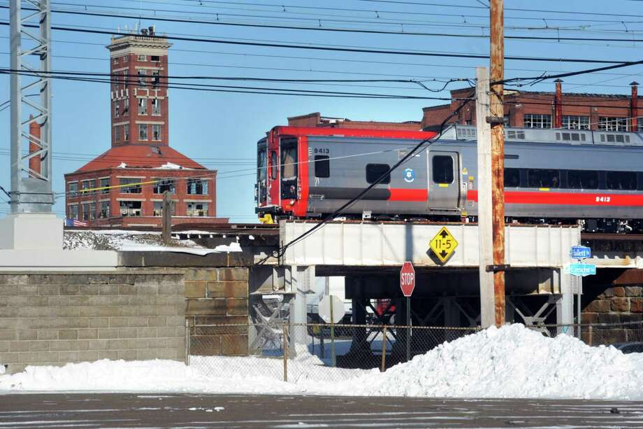 A Metro-North train passes through Bridgeport, near the site of the proposed train station for the city's East Side. Photo: Hearst Connecticut Media File Photo / Connecticut Post