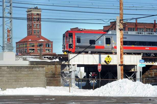 A Metro-North train passes through Bridgeport, near the site of the proposed train station for the city's East Side.