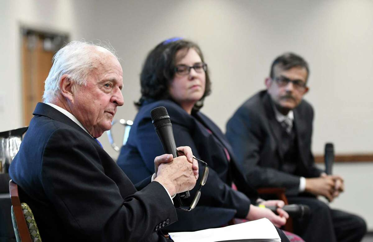 Hugh Johnson, the region's leading business analyst; Laura Schultz, senior analyst at the Rockefeller Institute of Government, and Kajal Lahiri, University at Albany Distinguished Professor of Economics, right, participate in an economic outlook panel discussion on Wednesday, Jan. 23, 2019, at Hearst Media Center in Colonie, N.Y. The event was part of the Times Union's leadership luncheon series. (Will Waldron/Times Union)
