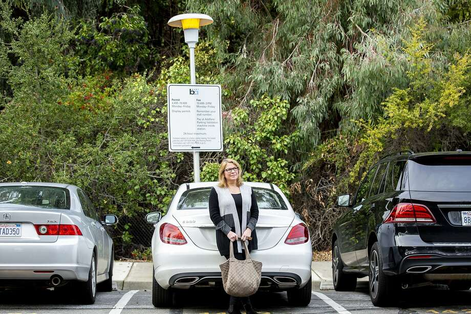 Joy Hoffmann paid $2,220 cash for another BART rider's permit to park in the Lafayette Station lot until she got a space in S.F. Photo: Santiago Mejia / The Chronicle
