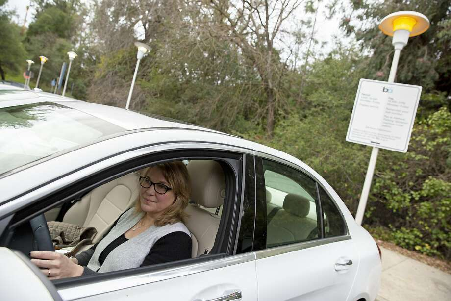 Joy Hoffmann at the Lafayette BART Station parking lot where she used to pay a premium to a permit holder for use of their tag. Photo: Photos By Santiago Mejia / The Chronicle