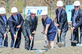 Employees and guests gather at ASML along Route 7 in Wilton on Thursday, May 3, 2018. The technology manufacturer broke ground on the first of three expansion rounds