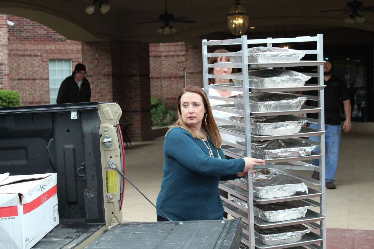 Stacy Arceneaux, Arbor Terrace-Kingwood's marketing director Stacy Arceneaux pulls a cart full of food to be delivered to air traffic controllers at the William P. Hobby and George Bush Intercontinental Airports on Jan. 23, 2019.
