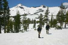 Hikers trek through the snow in the Desolation Wilderness near South Lake Tahoe.