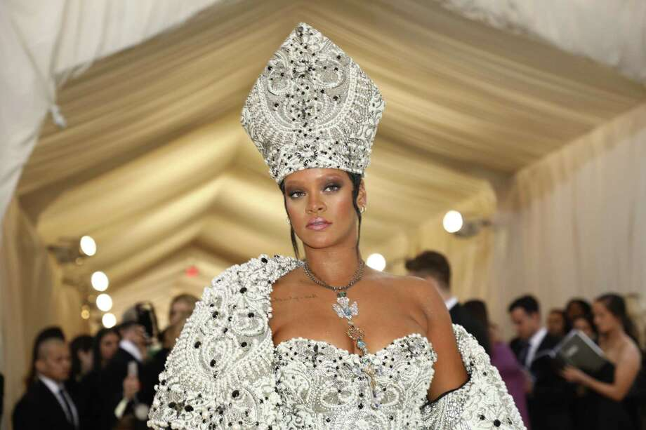 Rihanna at the Costume Institute Gala at the Metropolitan Museum of Art in 2018. Rihanna and Moët Hennessy Louis Vuitton LVMH are in the midst of a deal that would make her the first female designer of color at the world's largest luxury conglomerate. Photo: DAMON WINTER, STF / NYT / NYTNS