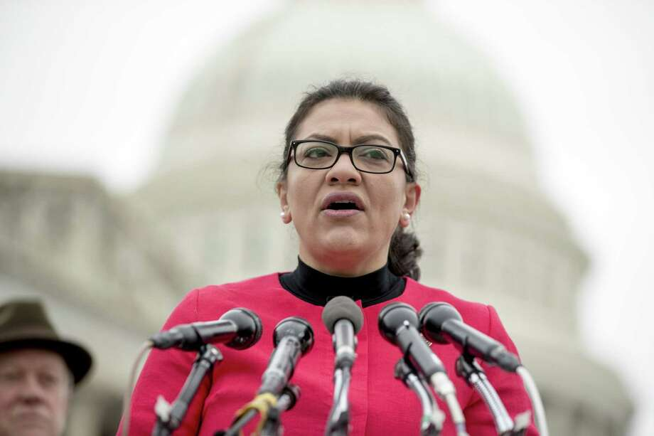 "Rep. Rashida Tlaib, D-Mich., speaks at a news conference on Capitol Hill Jan. 17. A newly minted representative, Tlaib gained notoriety quickly for referring to President Trump as a ""mother(expletive)."" Photo: Andrew Harnik /Associated Press / Copyright 2019 The Associated Press. All rights reserved"
