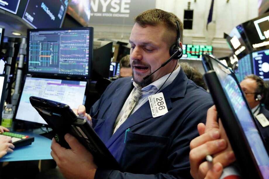 FILE- In this Jan. 18, 2019, file photo trader Michael Milano works on the floor of the New York Stock Exchange. The U.S. stock market opens at 9:30 a.m. EST on Wednesday, Jan. 23. (AP Photo/Richard Drew, File) Photo: Richard Drew / Copyright 2018 The Associated Press. All rights reserved.