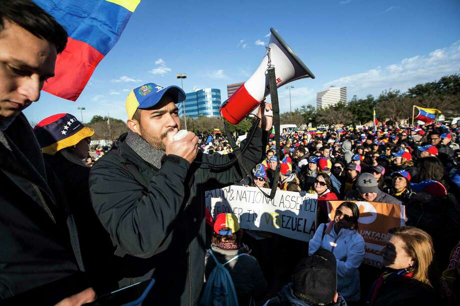 Jorge Marquez speaks to a large gathering of local Venezuelans as they demonstrate in reaction to recent political happenings in their home country on Wednesday, Jan. 23, 2019, in Houston. The demonstrators are gathering in support of Opposition leader Juan Guaido, who swore himself in as President of Venezuela, and against President Nicolás Maduro. President Trump announced today that he is recognizing Venezuelan opposition leader. Photo: Brett Coomer, Staff Photographer / © 2019 Houston Chronicle