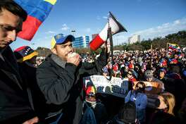 Jorge Marquez speaks to a large gathering of local Venezuelans as they demonstrate in reaction to recent political happenings in their home country on Wednesday, Jan. 23, 2019, in Houston. The demonstrators are gathering in support of Opposition leader Juan Guaido, who swore himself in as President of Venezuela, and against President Nicolás Maduro. President Trump announced today that he is recognizing Venezuelan opposition leader.