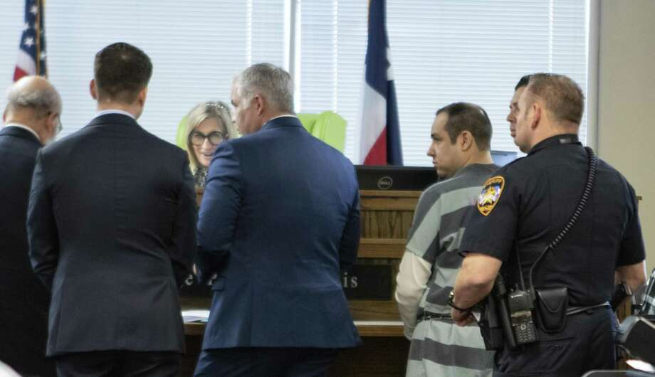 Rafael Leos Trejo, right, turns toward attorneys and judge Patty Maginnis as they discuss his case Thursday, Jan. 10, 2019 in Conroe. Trejo was charged with the murder of his wife. Photo: Cody Bahn, Houston Chronicle / Staff Photographer / © 2018 Houston Chronicle