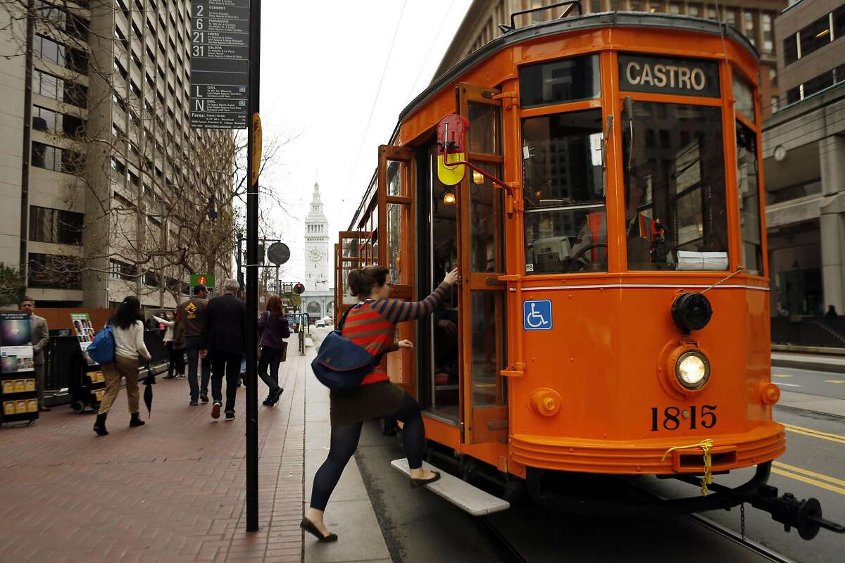 A passenger boards an F Line Castro streetcar on Market Street in San Francisco, Calif., on Wednesday, March 5, 2014. Muni F Line of historic streetcars are popular with both tourists who tour the city and locals who use them for commute. But there is a suggestion that fares might go up to a premium rate of $6 like the Cable Cars, instead of the standard Muni $2 fare that is paid today.