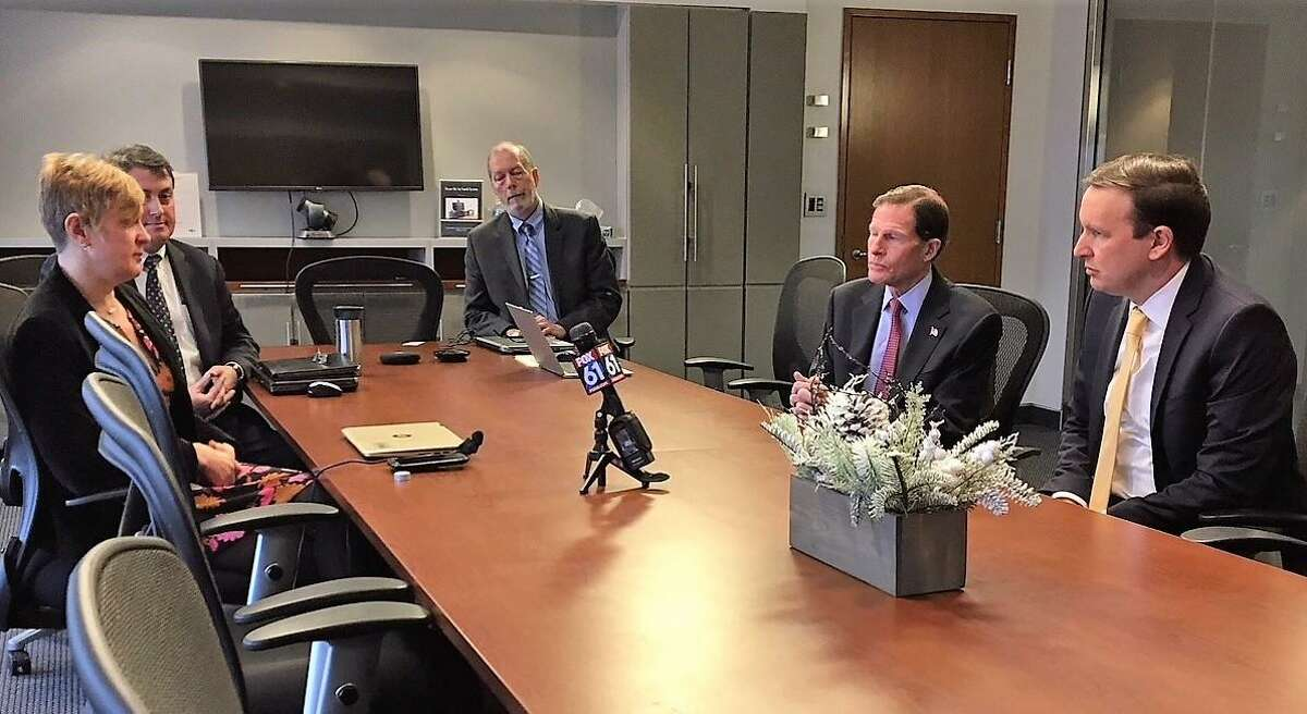 Erika R. Smith talking to U.S. Sens. Richard Blumenthal and Chris Murphy, both D-Conn., Jan. 23, 2019 on the government shutdown. She said she can't file her FDA application for a drug that the company says will allow nerves from the brain to the spinal cord to regrow.
