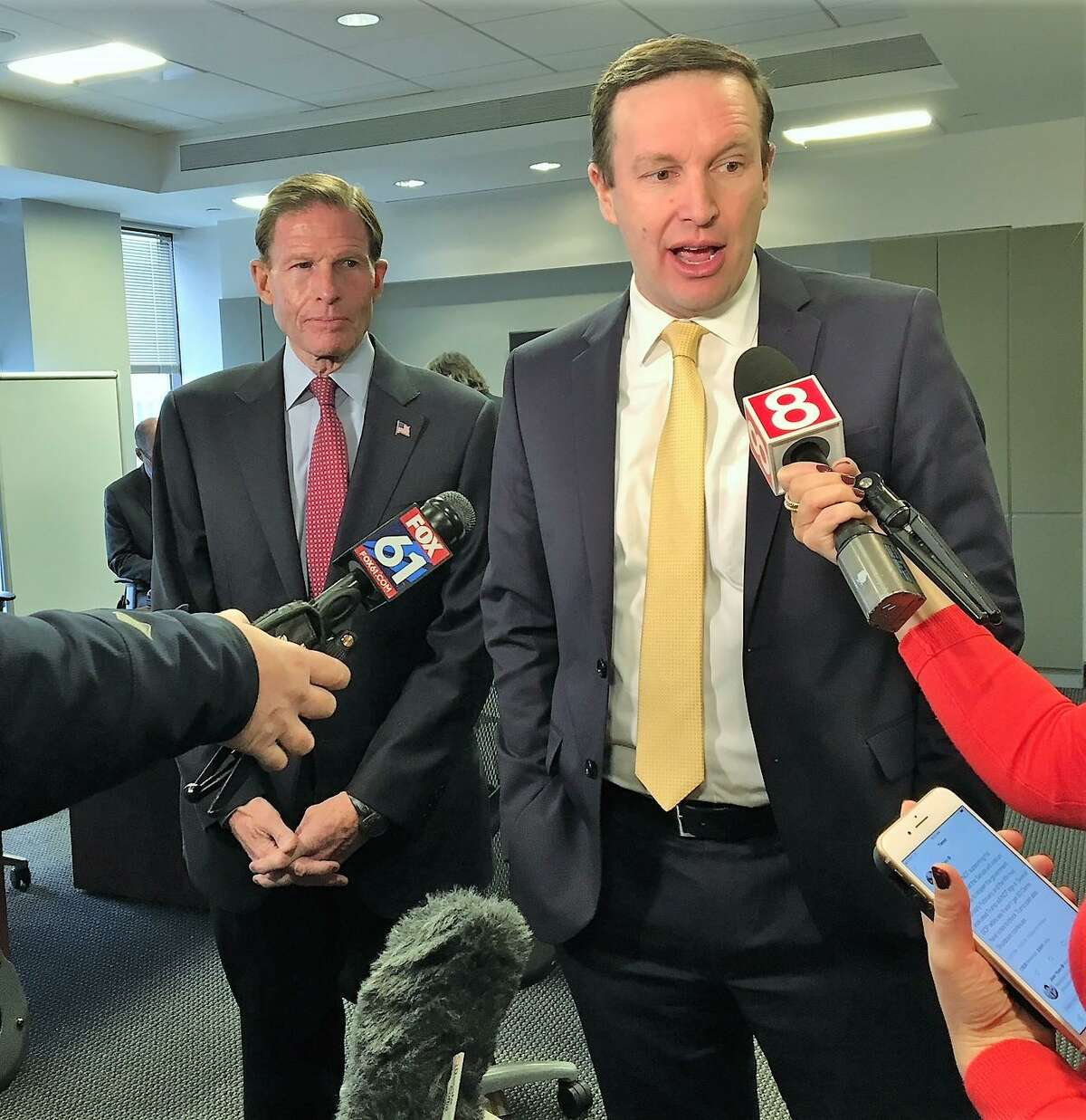 U.S. Sens. Richard Blumenthal and Chris Murphy, both D-Conn., speak at ReNetX Bio, Inc. Wednesday about the government shutdown. CEO Erika R. Smith said she can't file her FDA application for a drug that the company says will allow nerves from the brain to the spinal cord to regrow.