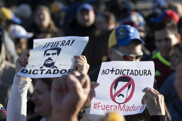 Local Venezuelans demonstrate in reaction to recent political happenings in their home country on Wednesday, Jan. 23, 2019, in Houston. The demonstrators are gathering in support of Opposition leader Juan Guaido, who swore himself in as President of Venezuela, and against President Nicolás Maduro. U.S. President Donald Trump announced today that he is recognizing Venezuelan opposition leader.