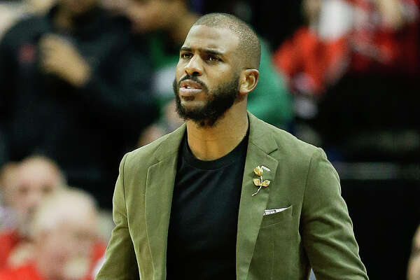 Houston Rockets guard Chris Paul watches from the sideline during the first half of an NBA basketball game against the Boston Celtics, Thursday, Dec. 27, 2018, in Houston. (AP Photo/Eric Christian Smith)
