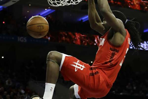 Houston Rockets' Kenneth Faried (35) dunks the ball as Philadelphia 76ers' Ben Simmons (25) , T.J. McConnell (12) and Landry Shamet (1) look on during the first half of an NBA basketball game, Monday, Jan. 21, 2019, in Philadelphia. (AP Photo/Matt Slocum)