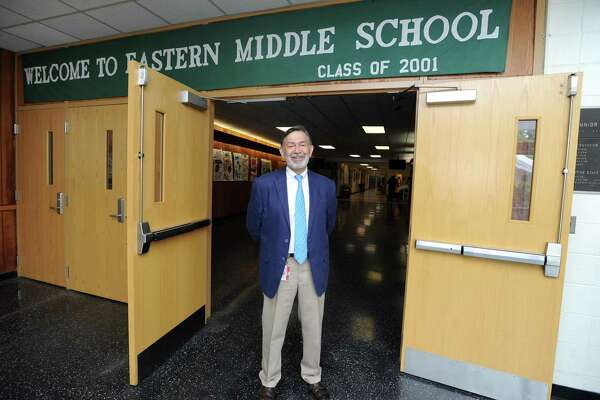 Former Eastern Middle School principal Ralph Mayo poses for a photo inside the Hendrie Ave. school in Greenwich, Conn. on Thursday, June 28, 2018. Mayo has been the interim superintendent of Greenwich Public Schools this entire school year.