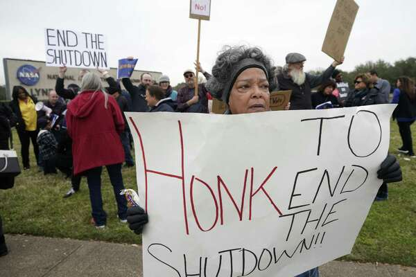 Valencia Budd, a retired NASA employee, protests with others outside of NASA's Johnson Space Center against the government shutdown Tuesday, Jan. 15, 2019, in Houston.
