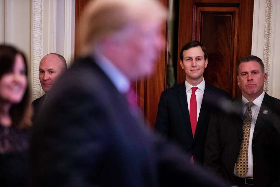 FILE-- Jared Kushner, senior adviser and son-in-law to Donald Trump, listens as the president speaks at a Hanukkah reception at the White House in December. President Donald Trump ordered his chief of staff to grant his son-in-law and senior adviser, Jared Kushner, a top-secret security clearance last year, overruling concerns flagged by intelligence officials and the White House's top lawyer, four people briefed on the matter said. Photo: Washington Post Photo By Jabin Botsford / The Washington Post