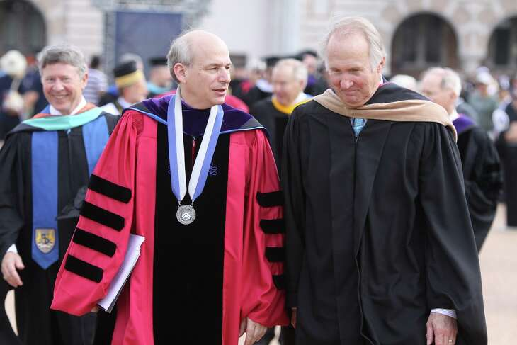 In this file photo from Friday, Oct. 12, 2012, Rice University President David Leebron and James Crownover, chairman of the Board of Trustees, talk as they leave the Centennial Address in the Academic Quadrangle at Rice University in Houston.