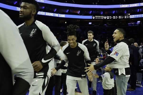 San Antonio Spurs' Lonnie Walker IV runs onto the court before an NBA basketball game against the Philadelphia 76ers, Wednesday, Jan. 23, 2019, in Philadelphia. (AP Photo/Matt Slocum)