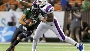 Louisiana Tech defensive end Jaylon Ferguson sacks Hawaii QB Chevan Cordeiro in the Hawaii Bowl on Dec. 22 in Honolulu. Ferguson had 45 sacks in his college career, an NCAA best.